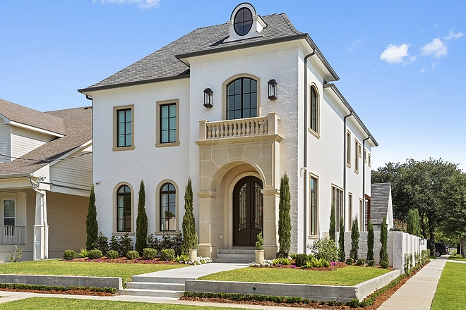 Exterior is brick with white mortar - sacking rub covering brick and Cast stone trim on windows and trimming front entrance #exterior #brick