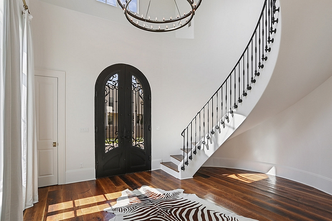 Iron Staircase with Iron Front Door Foyer The iron staircase railings was custom fabricated #IronStaircase #IronFrontDoor #Foyer #ironrailing #railing