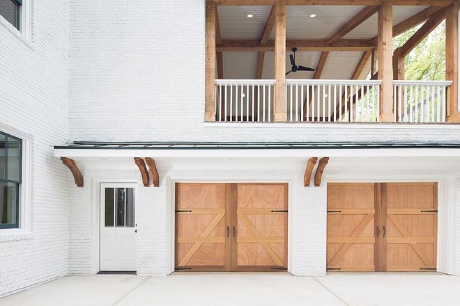Brick exterior with Cedar beams and cedar Garage doors Painted Brick exterior with Cedar beams and cedar Garage doors #Brickexterior #Cedarbeams #cedarGaragedoor