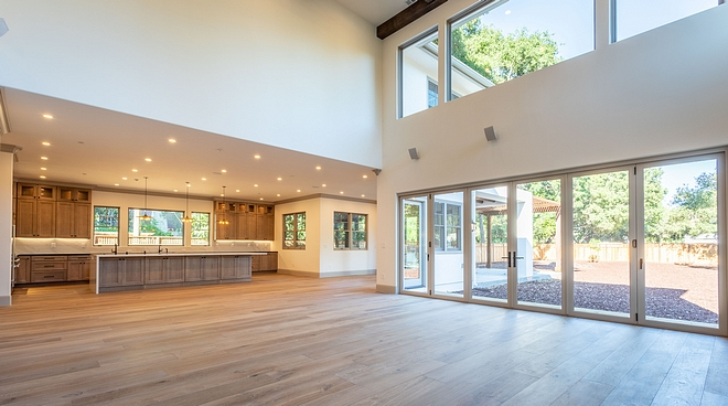 A wide view of the kitchen, breakfast nook and Great Room, which opens to the expansive backyard
