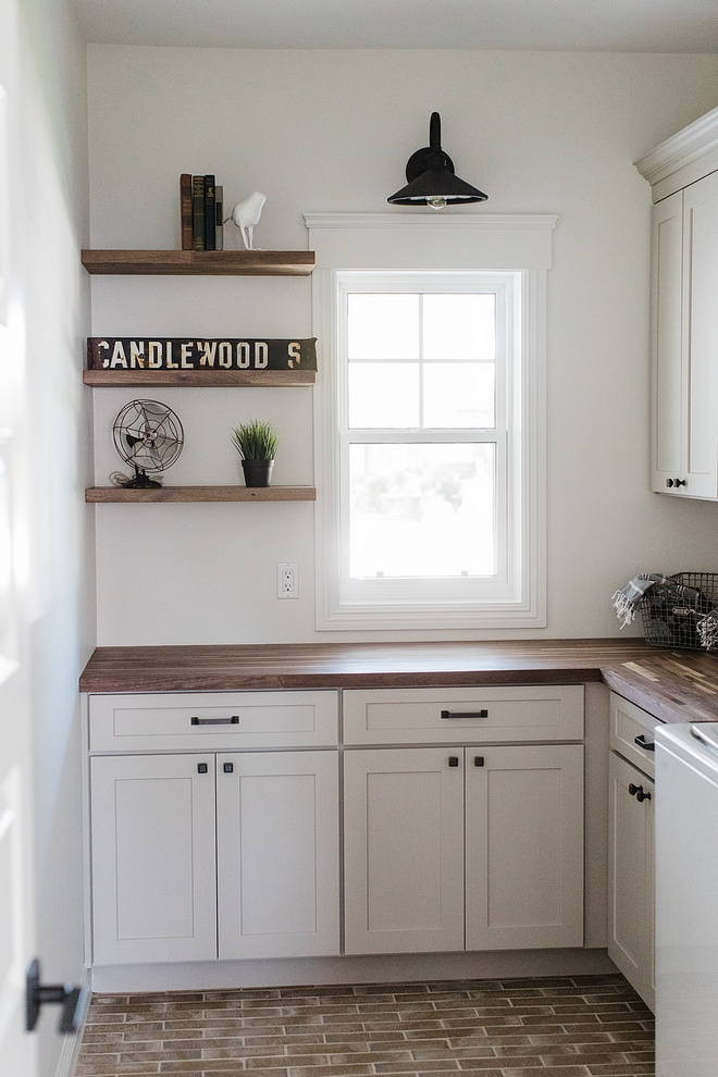 Farmhouse laundry room Farmhouse laundry room with Walnut countertop and Walnut floaring shelves laundry room #Farmhouselaundryroom #laundryroom