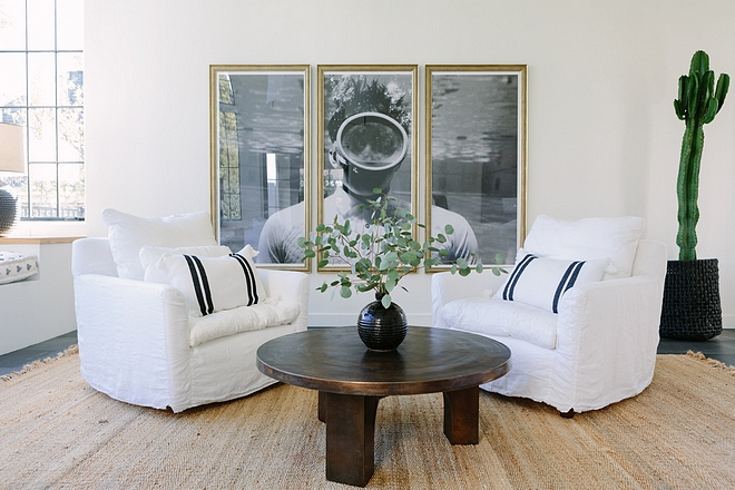 White Living Room We designed this space to be the perfect multi-functional space for a family that loves to entertain White Living room #whitelivingroom