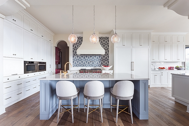 Kitchen The kitchen features custom cabinetry Perimeter and island features Quartzite with bevel square edge countertops #kitchen