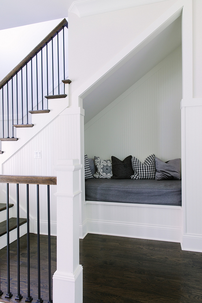 """Hang-out Nook"" under second staircase. Isn't this a brilliant idea?! Wainscoting and trim are painted in Simply White by Benjamin Moore Nook under stair Under stair nook #readingnook #understairnook #nookundertsairs"