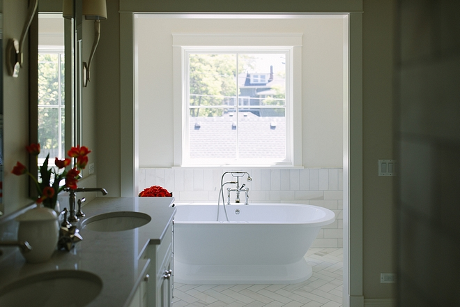 The bathroom also features a separate tub area with Carrara Wainscoting and Freestanding Soaker Tub