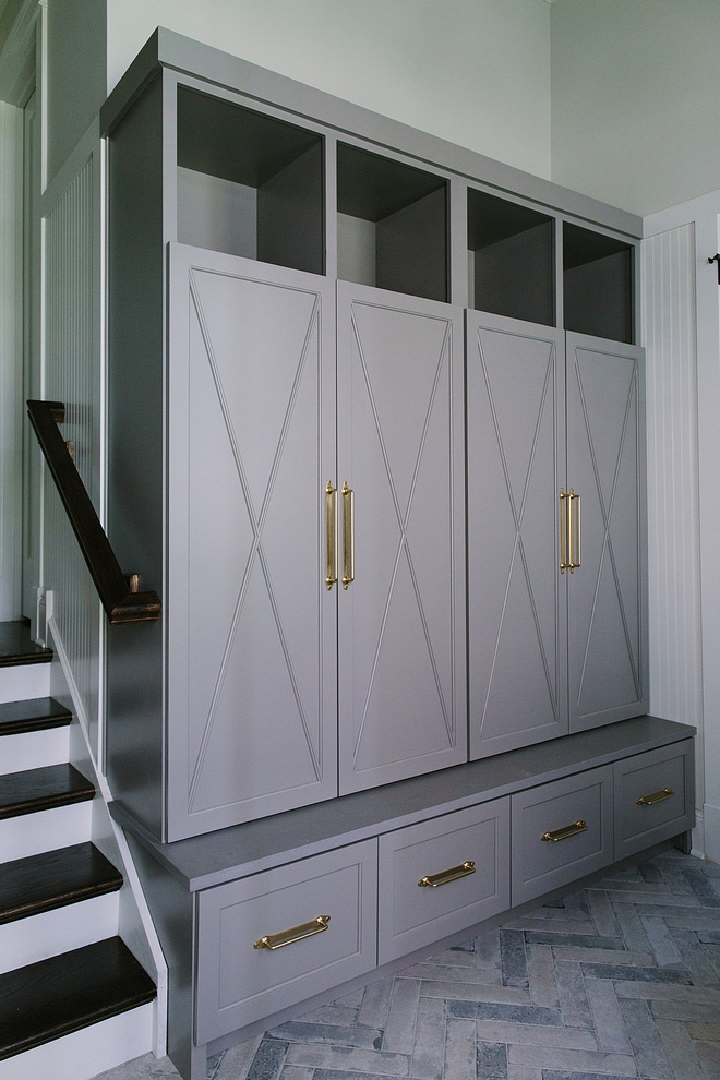 Mudroom cabinet is custom-designed and crafted cabinetry with X detail. Cabinet paint color is Benjamin Moore Graystone with Caesarstone ledge in Sleek Concrete #Mudroomcabinet #customcabinet #cabinetry #Xdetailcabinet #BenjaminMooreGraystone