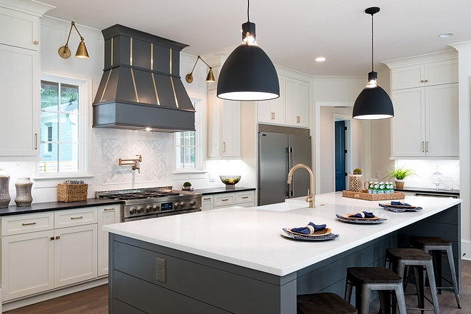 Modern Farmhouse Kitchen Would a modern farmhouse kitchen be completed without a shiplap island? We didn't think so. We choose the white quartz counter top on the island and white surround cabinets, but went with a grey island base and dark surround countertops #modernfarmhousekitchen #kitchen