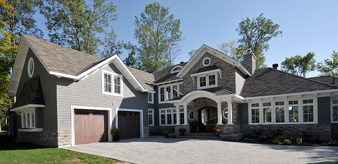 Lakehouse Lakehouse Lakehouse with grey siding and grey stone exterior Lakehouse Lakehouse #Lakehouse