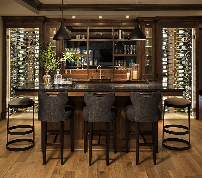 Basement Bar A custom built-in whisky bar and custom-designed abstract glass shelving are just the beginning of an amazing lower level designed for fun #basementbar #bar