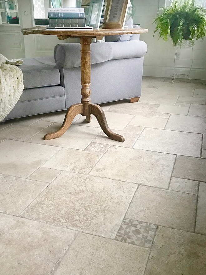 Tumbled stone flooring with cement tile insets