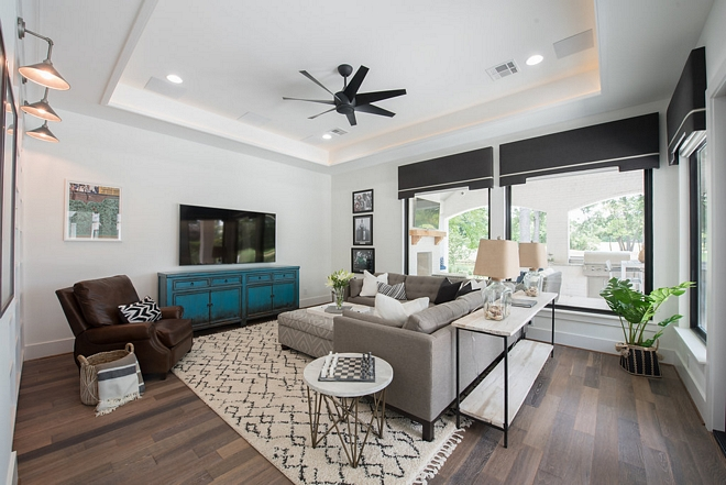 Family Room The family room opens directly to the pool and area This space is perfect to watch TV and spend some casual time with family and friends #familyroom
