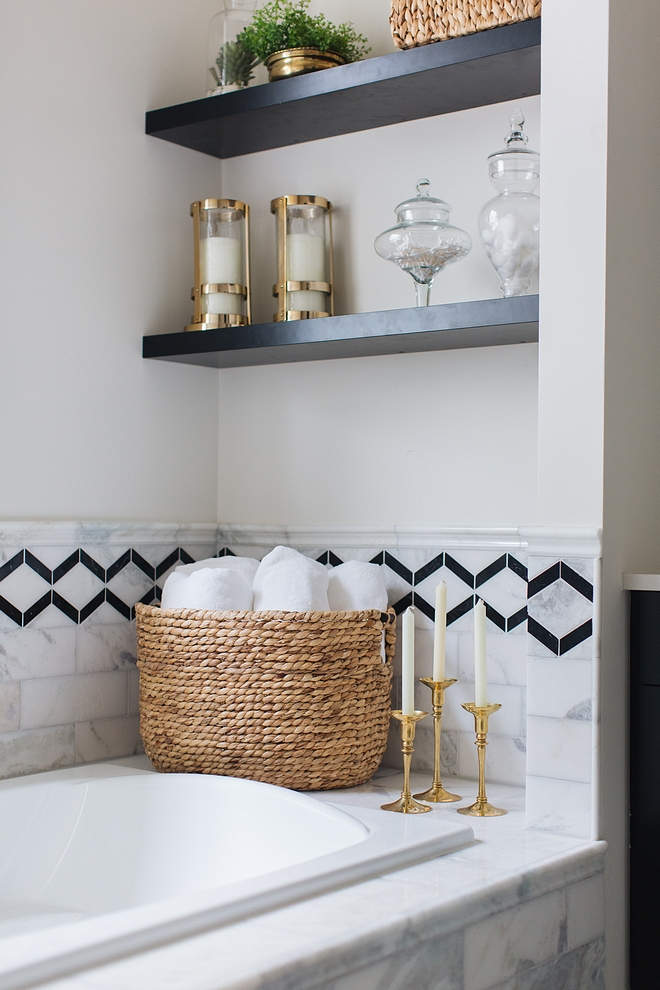 Bath nook tiling The tiling is a combination of Carrara marble tile with black accent tile #bathnook #tile
