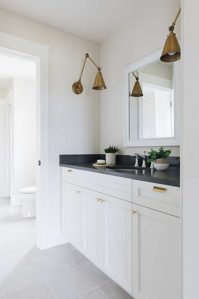 The Jack & Jill bathroom has a clean and uncomplicated design Trim and cabinet paint color is Benjamin Moore Simply White Walls are BM Classic Gray #Benjaminmoore