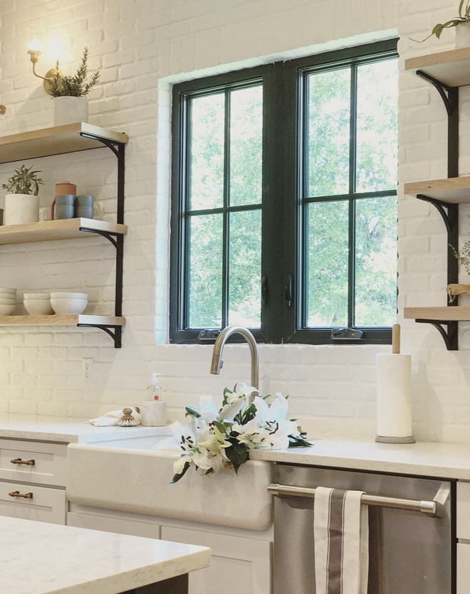 Painted Brick Backsplash Kitchen featuring painted white brick backslplash, black steel window and farmhouse sink #kitchen #brickbacksplash #paintedbrickbacksplash #whitebrick #brick #backsplash