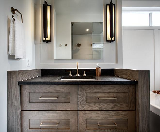 Bathroom Vanity Leathered Black granite countertop and large industrial sconces