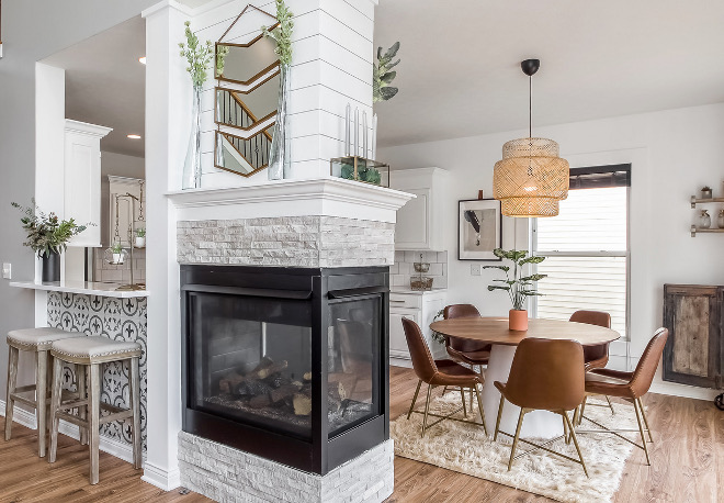Fireplace Renovation Ideas A 3-sided fireplace brings warmth to the breakfast room and family room #FireplaceRenovation