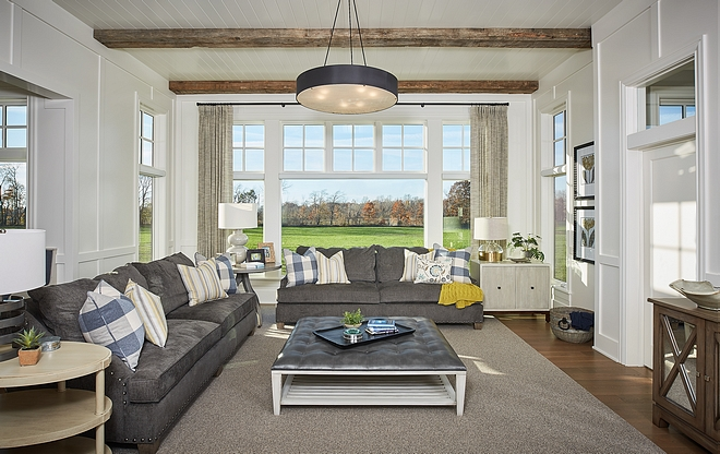 Living room Soothing wall colors, off-white trim, and natural wood floors ground the space and create a sense of calmness and warmth #livingroom