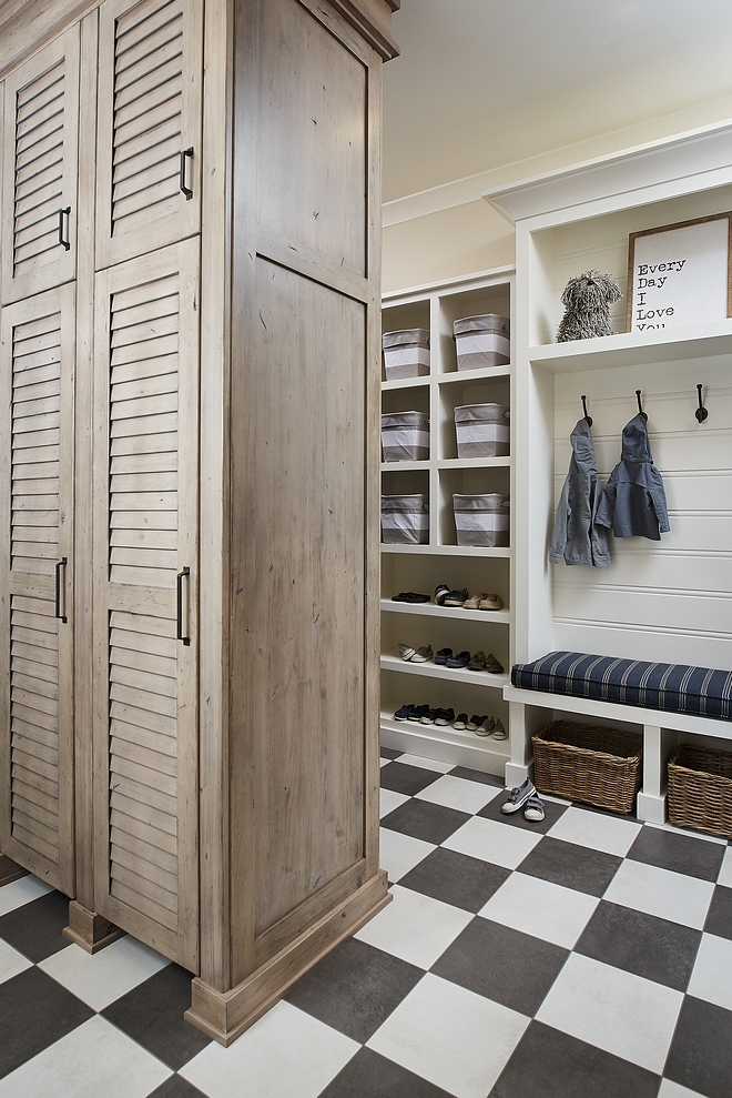 Mudroom Cabinet A custom cabinet with louvered doors divide the mudroom in two areas and keeps things more organized #mudroom #cabinet #louvereddoors #cabinetideas #mudroomdesign #mudroomideas