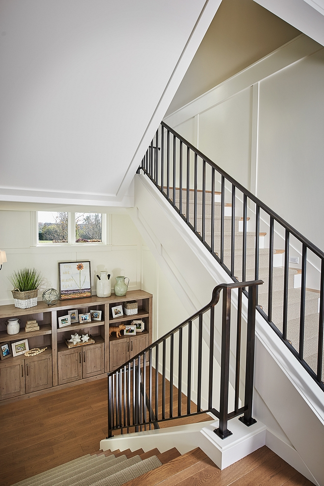 Benjamin Moore Swiss Coffee Staircase with horizontal board and batten paneling painted in Benjamin Moore Swiss Coffee Benjamin Moore Swiss Coffee #BenjaminMooreSwissCoffee #staircase #staircasepaneling #boardandbatten #paintcolor #paneling