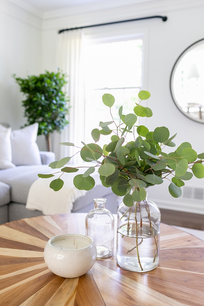 Coffee table decor A few branches of Silver Dollar Eucalyptus add a fresh feeling to the family room's coffee table #coffeetabledecor
