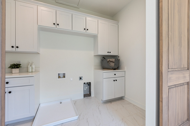 This home was staged and the washer and dryer weren't installed at the time these photos were taken I thought this is laundry room offers a great layout and I hope it inspires some of you Cabinets are painted in Benjamin Moore OC-117