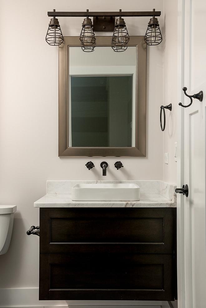 Industrial Bathroom Bathroom features industrial elements and a floating vanity #IndustrialBathroom #Bathroom #floatingvanity