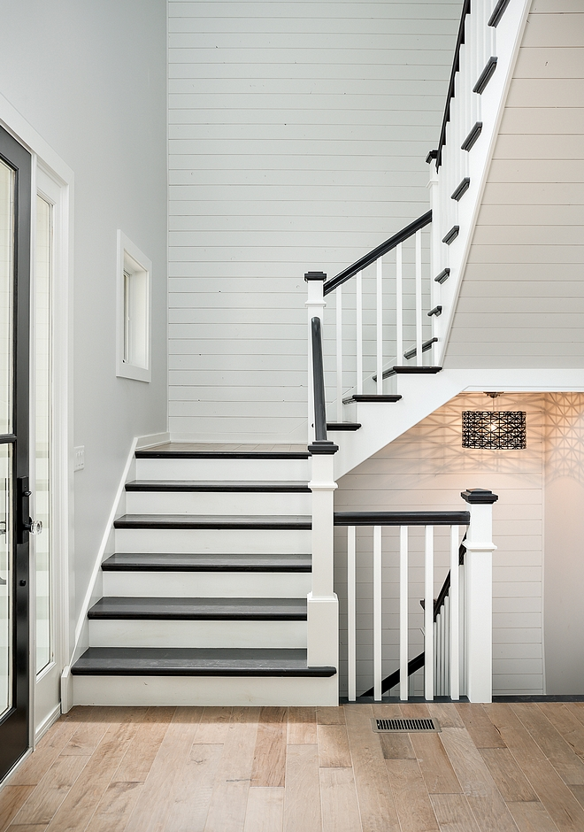 Shiplap was installed, not only on the wall, but also as paneling on the bottom of staircase This gives a seamless look to the entire space Shiplap paint color is White Dove OC 17 Benjamin Moore #shiplap #staircase #shiplapstaircase #WhiteDoveOC17BenjaminMoore