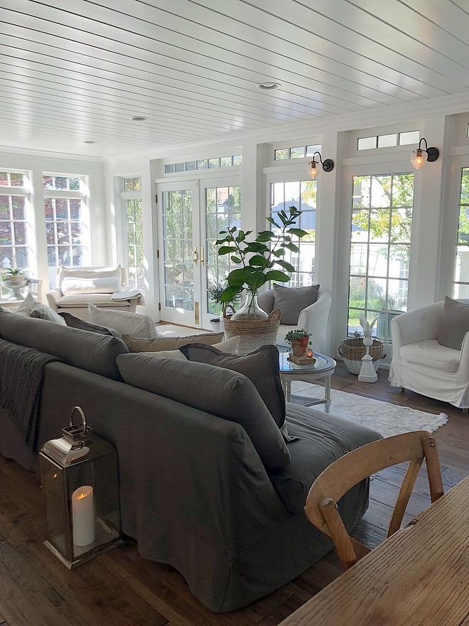 Hamptons inspired family room with tongue and groove ceiling, slipcovered sofas and slipcovered chairs #hamptonsinteriors #Hamptons #slipcoveredsofa #slipcoveredchairs #familyroom