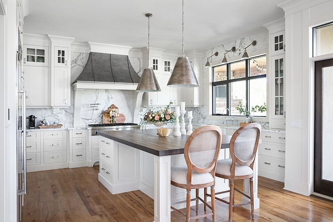 Kitchen butcher block top The island has a butcher block top, which is more durable than the marble and easily refinished #butcherblock
