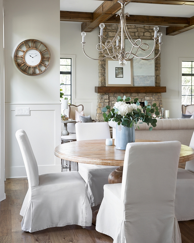 French inspired Breakfast room with Mango wood round dining table and white slipcovered dining chairs from Ikea French inspired Breakfast room with Mango wood round dining table #FrenchBreakfastroom #rounddiningtable