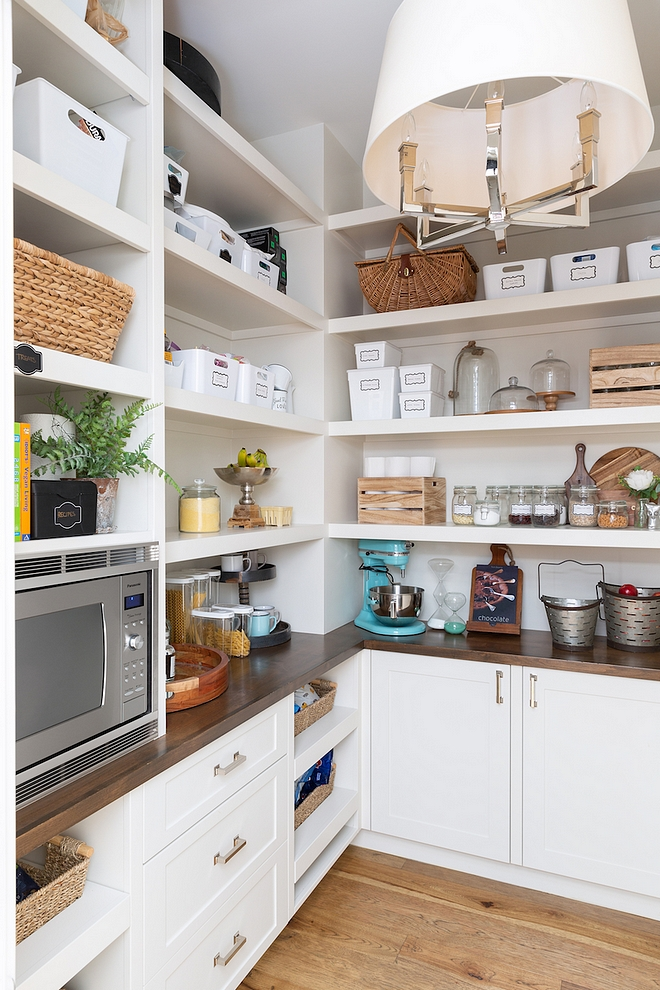 Pantry Pantry features a microwave oven I don't like the look of microwave in kitchen and putting it in the pantry is a great alternative #pantry