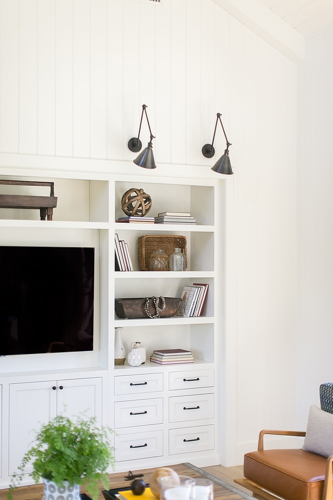 White Builtin media cabinet painted in BM White Dove with black pulls and black knobs above you will find vertical plank
