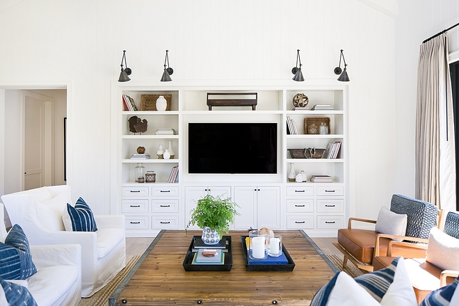 Living room without fireplace cabinet A custom built-in media cabinet creates a focal point in this living room. In fact, this is a good design layout if your living room doesn't have a fireplace #livingroomcabinet #livingroomwithoutfireplace