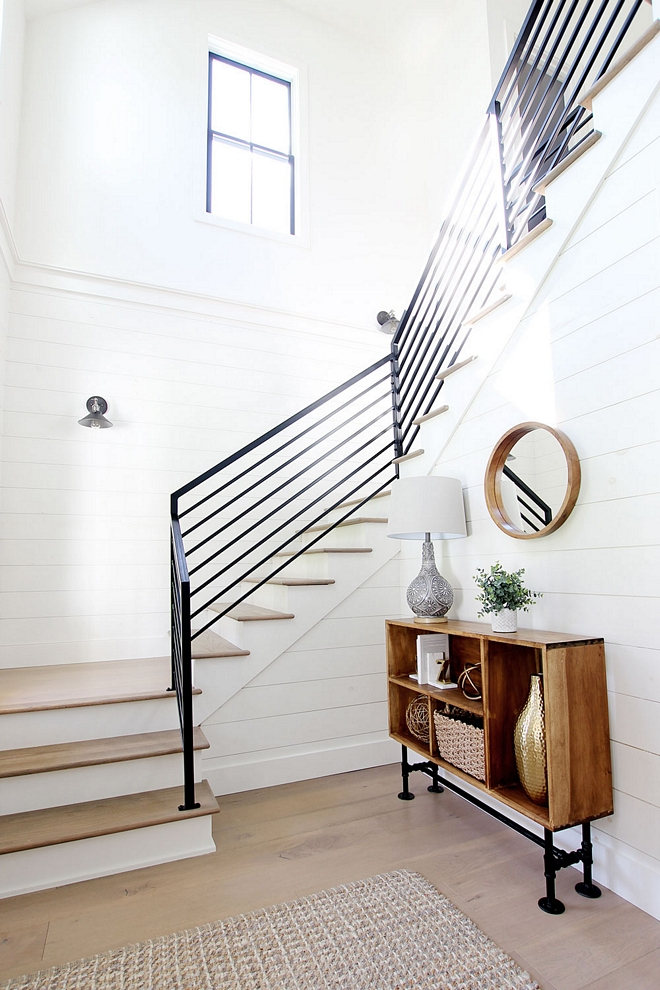 Vertical Metal Railing Modern Farmhouse Railing We went with a simple black industrial metal railing. We love the clean modern lines it creates in this space, and it goes perfectly with the windows and lighting. And the best part is that it was more affordable than traditional wood railing Vertical Metal Railing #VerticalMetalRailing #VerticalRailing