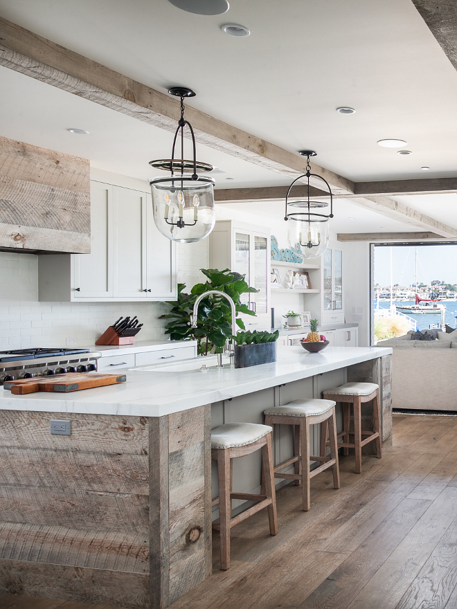 Rustic Kitchen island with reclaimed shiplap and Michaelangelo Calcutta honed countertop Rustic Kitchen island with reclaimed shiplap, reclaimed shiplap hood and reclaimed wood beams #RusticKitchen #reclaimedshiplap