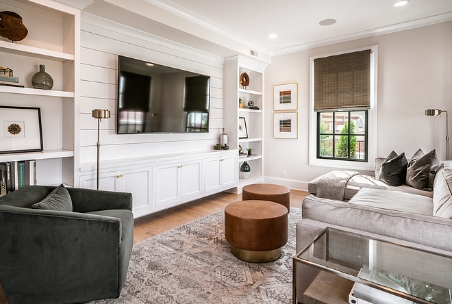Small family room tv room with custom built-ins The space also features custom built-ins with shiplap tv room with custom built-ins #tvroom #familyroom #builtins #shiplap
