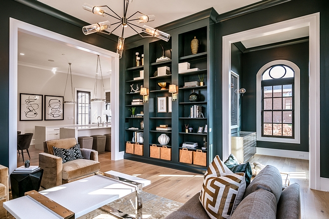 Living room furniture The foyer leads you to a dramatic living room with built-in bookcases and high-end furnishing #licingroom #livingroomfurniture #furniture #furnishings