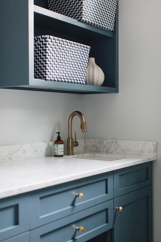 Blue cabinet with White Carrara countertop Blue cabinet whith white marble countertop , brass hardware and brass faucet #Bluecabinet #whitemarble #countertop