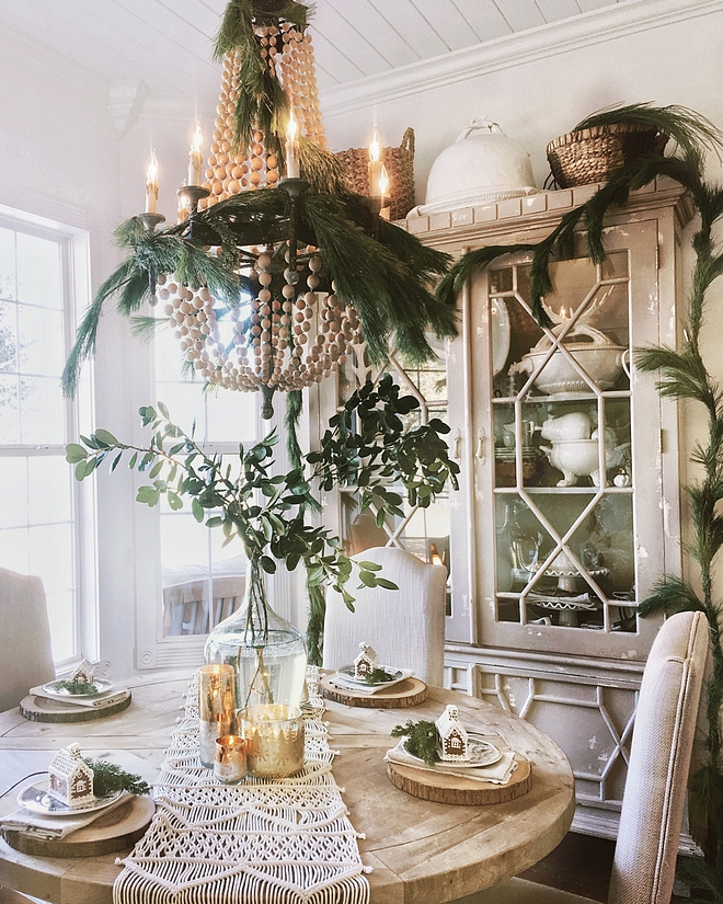 Natural Christmas Decor Dining room with Natural Christmas decor on chandelier Natural Christmas decorating ideas Easy and affordable way to decorate for Christmas #NaturalChristmasDecor #ChristmasDecor #NaturalDecor