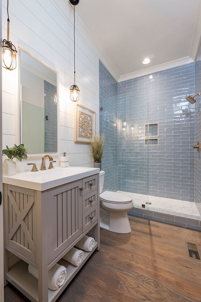 Coastal Farmhouse bathroom with shiplap walls, store-bought vanity and hardwood flooring and blue subway tile Neutral coastal Farmhouse bathroom Farmhouse bathroom ideas #coastalFarmhousebathroom #coastalbathoom #Farmhousebathroom #bathroom