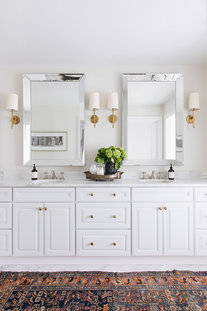 Bathroom Cabinets are painted in Benjamin Moore Decorator's White White Bathroom Cabinet Paint Color #BathroomCabinet #whiteBathroomCabinet #Decoratorswhitebenjaminmoore