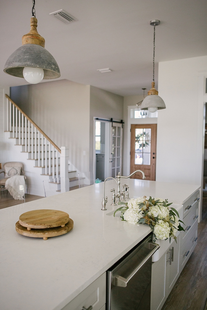 The kitchen island features the same quartz countertop, Snow Point Kitchen island quartz countertop #kitchen #kitchenisland #quartzcountertop