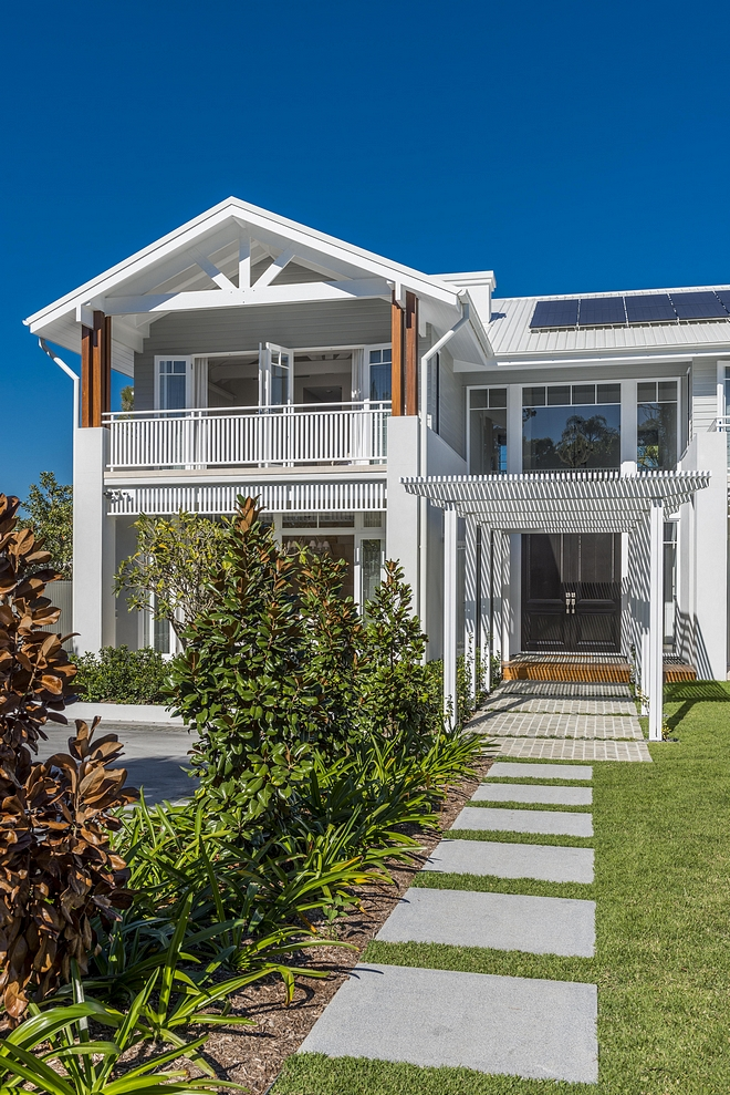 Beach House Architecture We used tin roof and weatherboard, so it picks up the Brisbane vernacular, then we've spiced it up a little bit There are traditional elements with Colonial and Caribbean influences as well Beach House Architecture #BeachHouse #BeachHouseArchitecture