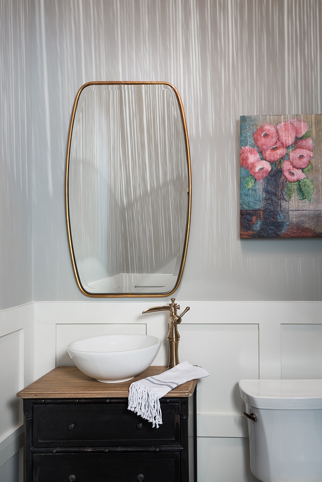 Mindful Gray by Sherwin Williams The powder room features grid board and batten chair rail and an antique dresser turned into vanity Walls are Mindful Gray by Sherwin Williams #MindfulGraySherwinWilliams