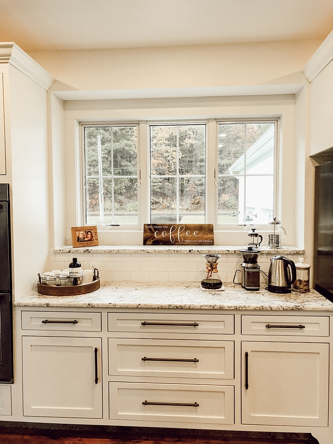 Kitchen Coffee station with White Granite countertop Cabinets are shaker style white custom color match Kitchen Coffee station Kitchen Coffee station #KitchenCoffeestation #Coffeestation #Whitegranite