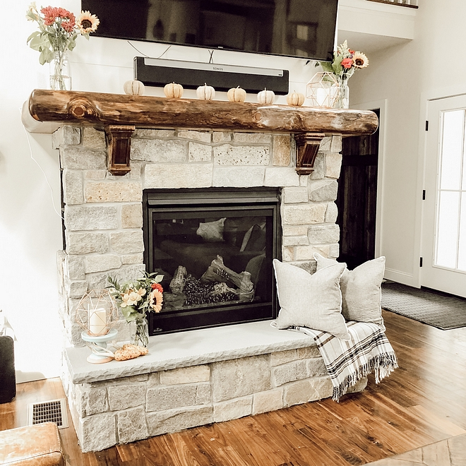 Log Mantel A custom log mantel adds a rustic feel to this stone fireplace #log #logmantel #mantel
