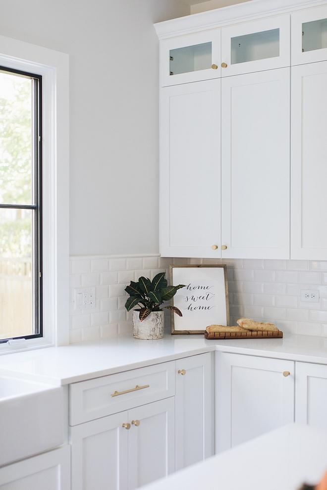 Kitchen with white cabinet white quartz countertop and 3x6 Bevel Square Edge Field White Glossy tile White kitchen Backplash #Kitchen #whitecabinet #whitequartz #countertop #3x6Beveltile #WhiteGlossy #beveltile