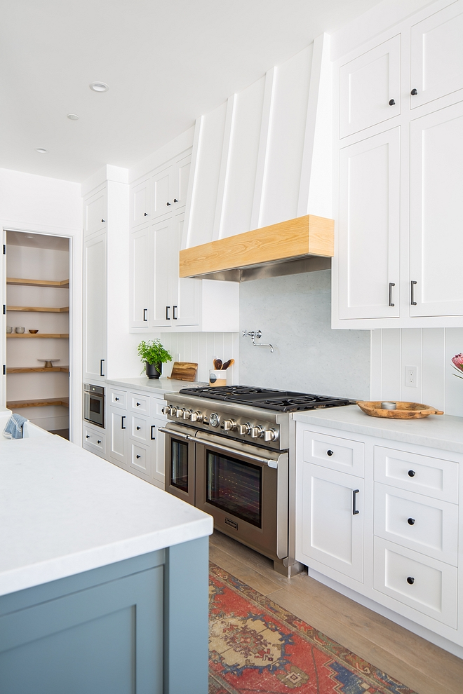 Kitchen Cabinetry Kitchen Cabinetry Kitchen Cabinetry Shaker Style, Face Framed Cabinetry Throughout Three Finishes; white painted around the perimeter and at range elevation, dark gray on island and white oak at buffet elevation and on hood detail #KitchenCabinetry #Kitchen #Cabinetry