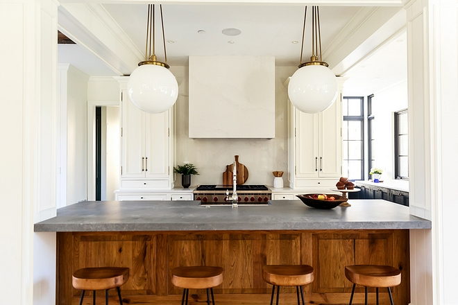 Kitchen Wolf range, Shaws fireclay farmhouse sink and an expansive island makes this a home-cook's dream kitchen Walls are Benjamin Moore White Dove #kitchen #BenjaminMooreWhiteDove #kitchenpaintcolor #kitchens #kitchendesign #kitchenproject #kitchenreno #whitekitchenpaintcolor #whitekitchen #kitchenisland #woodcabinet #kitchenwoodcabinet