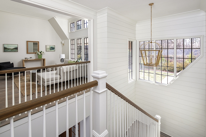 Shiplap A shiplap lovers heaven on earth A grand U-shaped staircase with floor to ceiling shiplap takes you from the first floor up to the second A unique pentagonal shaped window set brings in natural light #shiplap #shiplapstaircase #staircase #window